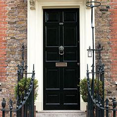 Paint a High-Gloss Front Door: A handsome front door shines in @farrowball Pitch Black.