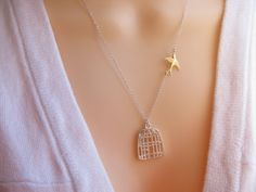 Fly Free Bird Necklace Silver Birdcage Necklace With Flying Sparrow. $ 24.80, via Etsy.