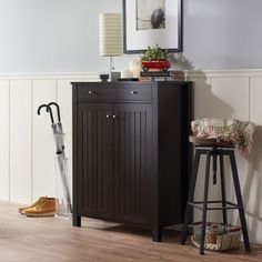 Simple and compact, this charming shoe cabinet provides a stylish option for organizing your footwear. The structured design provides four shelves hidden behind the slatted panel cabinet doors while a slim top drawer holds any entryway accessories.