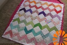 Quilted flowers in the white sqs is way cute! - Piece N Quilt: Zig Zags and Flowers - A Girly Quilt - Machine quilting by Natalia Bonner of Piece N quilt