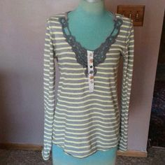 """Free People Shirt Yellow and Blue cotton striped design with button up front has crochet design around neck line raw hemline around bottom is 27""""long looser fit Free People Tops"""