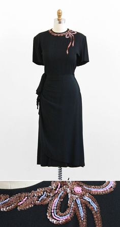 vintage 1940s black dress with a sequin bow neckline.