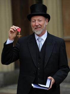 Richard Thompson receives an OBE from the Queen