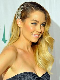 Lauren Conrad half swept back hairstyle with hair accessory