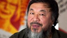 Chinese artist and activist Ai Weiwei in his room of portraits of Australian human rights activists, part of the Andy Warhol|Ai Weiwei exhibition at the National Gallery of Victoria.