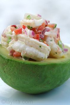Delicious recipe for shrimp stuffed avocado made with ripe avocado filled with shrimp, red onion, radish, bell pepper, celery and cilantro aioli salad.
