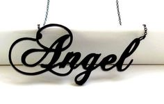 """This necklace features the word - """"angel"""" (3"""" ,or 76mm) made of black acrylic. It comes on a black finished Cable chain.     The necklace measure approx: 18"""" (45cm).     If you need a different length please let me know in the """"message to seller"""" section of the checkout process .     All of my jewelry comes with a gift box.  Price: $27"""