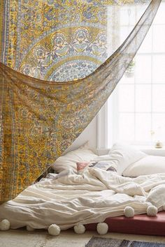 bohemian bedroom ideas - ultra low bed and translucent wall hangings. For a really low bed take a look at: http://www.naturalbedcompany.co.uk/shop/contemporary-beds/kobe-low-bed/
