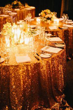 Glittery gold wedding reception tables | Brides.com