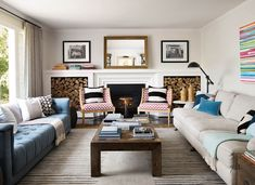 VIBRANT- Make 2 different sofas work together by having other elements matchy-matchy.