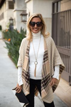 Our Camel Reversible Plaid and Houndstooth Poncho is perfect for fall and the holiday season - Featured on my blog and available in our shop www.jacketsociety.com