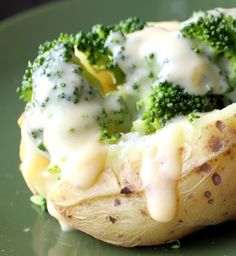 Crock Pot Baked Potatoes with Broccoli Cheddar Cheese Sauce