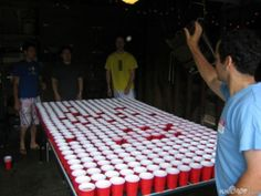 crazy beer pong, they should do 1/2 the table red and 1/2 the table blue or at least split it up somehow.... but AWESOME!