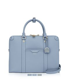 The West 57th Briefcase belongs in every business-minded Bendel Girl's luxury handbag collection. Designed with the modern professional woman in mind with Saffiano leather, custom Henri Bendel details and a dedicated laptop compartment, this chic designer handbag is not your mother's briefcase.