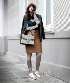 Shop from the best fashion sites and get inspiration from the latest fishnet tights. Leather A Line Skirt, Brown Leather Skirt, Skirt Tumblr, Skirts With Boots, Looks Street Style, Fishnet Tights, Striped Turtleneck, Skirt Belt, Winter Skirt