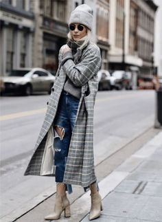 A tweed coat paired with a beanie, chunky sweater, destroyed jeans, and ankle boots.