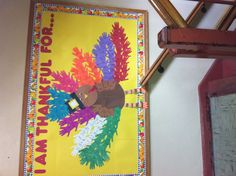 Thanksgiving bulletin board each grade get a color and each kid write on there hand???