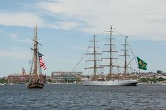 The Pride of Baltimore II and the Cisne Branco from Brazil pass by Fort McHenry as they sail into Baltimore's Inner Harbor.