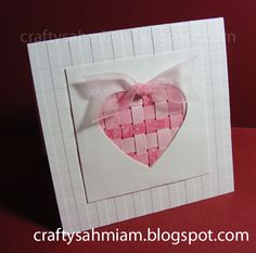 complete handmade Valentine with paper weaving in the background of the negative cut heart .. sweet!!