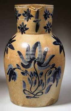 Stoneware pitcher decorated in blue
