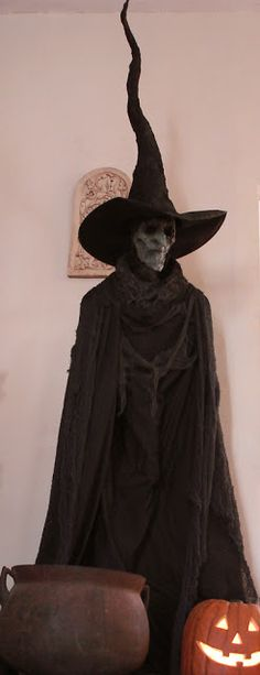 Witch - use sewing body form, witch mask, witch hat, and cape...can use blinking lights inside of mask for glowing eyes or place glow eyes behind the mask for wicked eyes.