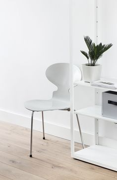 Arne Jacobsen ant chair (Love the crispness of white and how little potted plant accents)