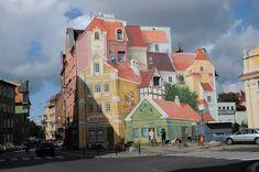Un murale 3D a Poznan, Polonia, dipinto per celebrare la storica area del mercato