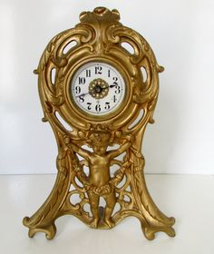 Victorian Cast Iron Clock Cherub Cupid Gold by nanascottagehouse