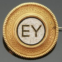 """Gold brooch with micromosaic Greek letters signifying """"good health"""" by Castellani, 1880"""