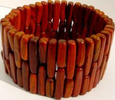 Stretch bracelet made from wood.  Beautiful!  http://cbdesigns.tripod.com/1d504f240.jpg
