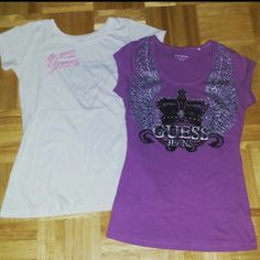 Guess Logo T-shirt Bundle♥ Two Guess factory t-shirt for an amazing price♥ Purple scoop neck t-shirt has a bejewled crown (all jewels are attached), with sparkle angle wings? size xs and in good condition. White logo scoop neck has faded gray logo with pink logo stitching, size small but also fits xs♥ G by Guess Tops Tees - Short Sleeve