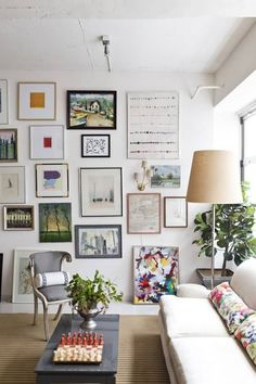 Art hung from floor to ceiling.