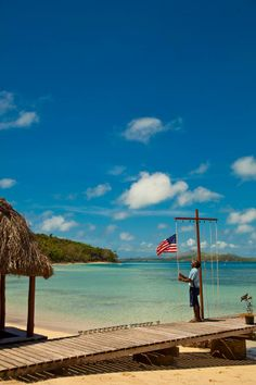 This morning Atu raises the flags of the countries where our current guests come from. This symbolizes the welcoming of their culture and history to ours! Vinaka Atu! #onlyonturtleisland @Stephie James Couture Portraits Island Fiji  http://www.turtlefiji.com/About-Us/Our-People/#.U2Jlflzvsdt