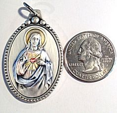 $95 Large Sterling Enamel Pendant Sacred Heart Jesus Christ Medal  (Image1)Rare Large religious medal. ITALIAN Heirloom Embossed very detailed pendant is STUNNING and features The Sacred Heart of Jesus Christ, Enamel colors of blue, gold, pink on sterling silver
