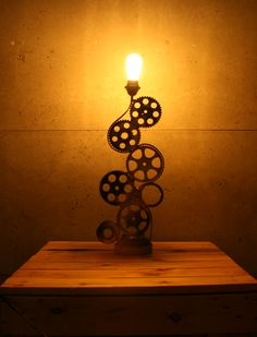Steampunk lamp. This metal lamp will ideally decorate industrial interior. Recycled from car parts. Handmade by Veqilo.pl #lamp