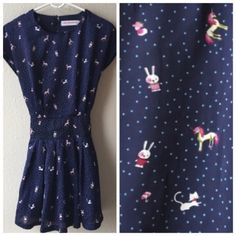 Magical cat and unicorn print bow dress  Adorable unicorn, rabbit, kitten and mushroom print on this dark blue tie-back dress. This dress has satin-like material and ties into a bow in the back. Light pleating on both sides above and below the waistline for a snug fit! Adjustable tie waist with zipper. Funk & Standard size S. Excellent condition. Funk & Standard Dresses Mini
