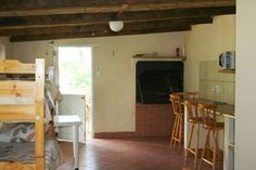 """July se huis""  Sleep 4 people with all four single beds in the main room. The  bathroom has a shower, basin and toilet. The kitchenette comes with a fridge, microwave, kettle, electric frying pan, toaster, necessary cutlery and crockery, braai grid, braai thongs & dish cloths. We also supply starter quantities of dishwash liquid, t-paper, coffee, tea, sugar and milk. Indoor and outdoor braai facilities are available and a private deck. Wood is on sale. Shower Basin, New Modern House, Single Beds, Self Catering Cottages, Have A Shower, Kitchenette, Thongs, Toaster, Open Plan"