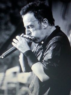 Bruce Springsteen- he is one great harp player! ( harmonica actually)