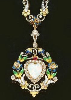 A diamond, opal, and enamel pendant.