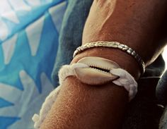 DIY Shell and repurposed old tee bracelet.