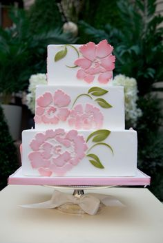Pretty pink-flowered wedding cake, as seen on Roxy Cakes.