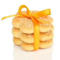Receita de Biscoitinhos Amanteigados de Laranja. A delícia do biscoito amanteigado e o toque cítrico da laranja, derrete na boca!