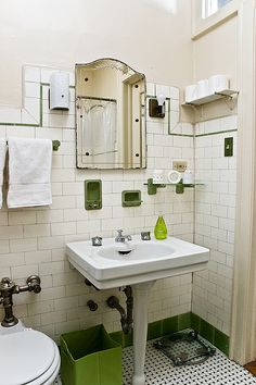 green vintage bathroom.  http://victoriaelizabethbarnes.com/vintage-bath-cove-molding-pedestal-sink-subway-tile/