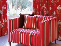 Poppy color perfection in a floral motif as well as bold striping. Mix patterns for impact. #patterns #stripes #furniture