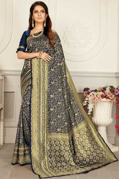 Navy Blue banarasi silk saree with navy blue silk blouse. Embellished with Woven zari work. Saree with Round Neck, Half Sleeve. It comes with unstitch blouse, it can be stitched to 32 to 58 sizes. #navy blue #banarasi silk #saree #blouse #Andaazfashion #UK