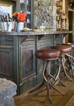 What's not to love about this Western style bar? Gorgeous, turquoise colored counter with metal accents is complemented by deer antler stools. What a perfect setup for a #WesternHome!