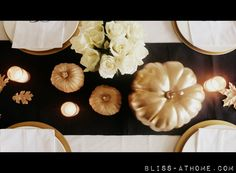 Fall decor. Black and white linens create a backdrop for gold pumpkins and leaves to shine on this fall tablescape
