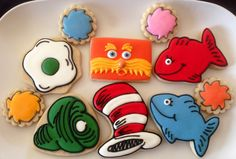 Dr. Seuss themed sugar cookies by What The Cookie! Confections. Cat in the hat; green eggs & ham; red fish blue fish; lorax