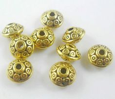 Tibetan Gold-Plated Disc Shaped-Point Spacer 7mm Beads offered by Half-Penny Boutique. $3.99 https://www.etsy.com/listing/129874021/tibetan-gold-plated-disc-shaped-point