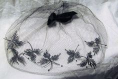 "Vintage 1950s Black Birdcage Veil Vintage Prayer Cap Embroidered Veil Net Blusher Velvet Bow Vintage Hat Accessory Fascinator    Shipping Is Free On This Item!    Delicate Veil covers whole head.  this is embroidered with a lief motif across the front and accented by tiny black crystals.  black velvet bow at crown.  wear alone as a fascinator or with another hat to add mystery!  net is true black.  it is 8"" from crown to edge.  one very small tear in net.  so beautiful!    if you have a…"